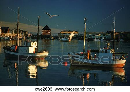 Stock photo of fishing boats in harbor at midnight in for Circle fishing boat