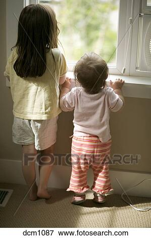 Picture Of Little Girl With Long Brown Hair Standing With