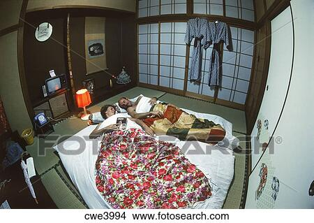 Stock photo of couple sleeping on futon in typical for Bed and breakfast tokyo
