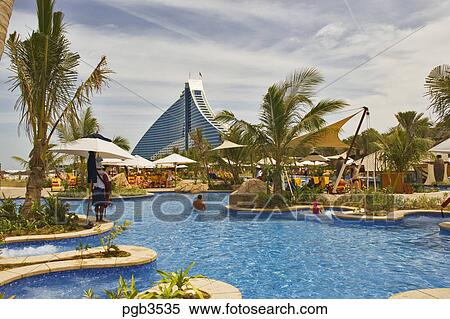 Stock image of swimming pool and recreation area at - Jumeirah beach hotel swimming pool ...