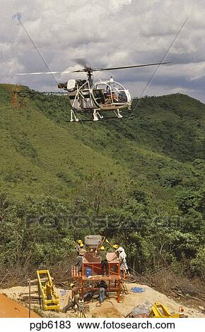Stock Photo Of Helicopter Pouring Concrete For Pylon