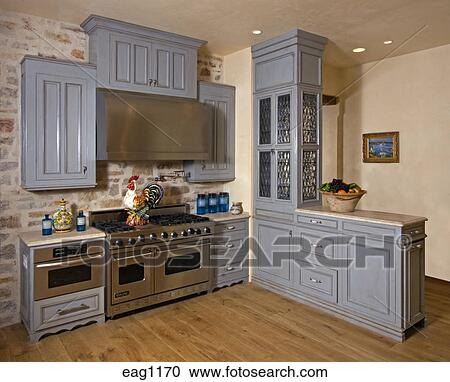 kitchen in luxury home with oak cabinets stock photo   Stock Photography of KITCHEN with cabinets, oven, stove ...