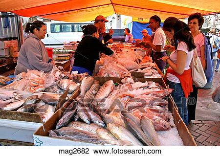 Stock photo of fish vendor at public market civic plaza for San francisco fish market