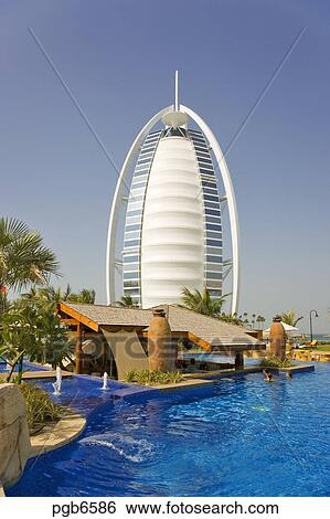 Stock images of dubai view of burj al arab hotel over for Garden pool dubai