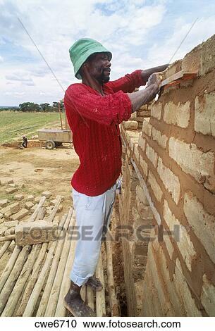 Stock Photography Of African Man Building Small Scale Brick House