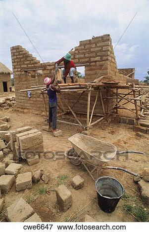 Picture Of African Men Building Small Scale Brick House On Tobacco