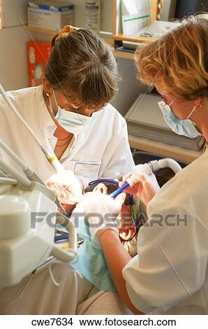 Stock Photo Of Female Dentist And Assistant Working Together On