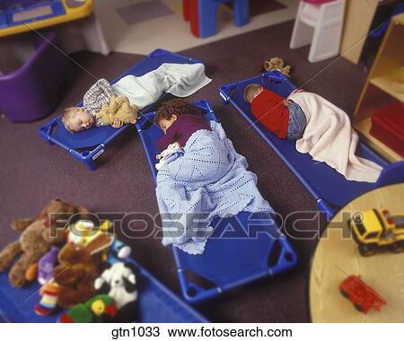 Stock Photo Of Children Sleeping On Floor Mats At A