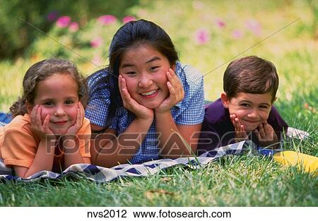 Stock Photo of Portrait of Asian teenage babysitter and young boy ...