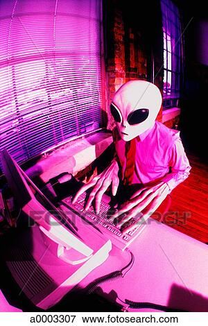 Picture Of Pink Alien Hand Computer Keyboard