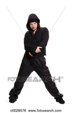 Stock Images of Silhouetted gangster type man standing ...