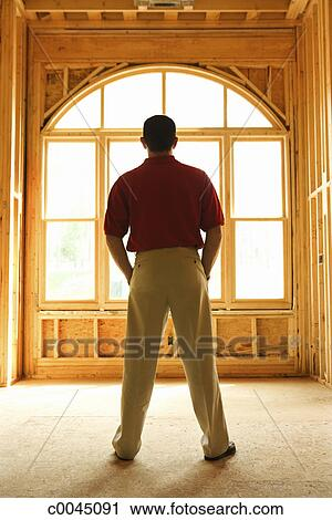 Inside Front Door Clipart stock photography of silhouette of a man in front of an arched