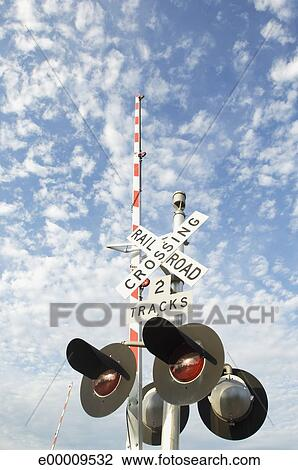 stock photo of railroad crossing lights and crossing bar