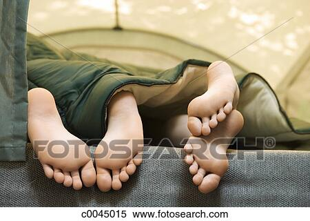 stock image of children 39 s feet in sleeping bag c0045015 search stock photos mural pictures. Black Bedroom Furniture Sets. Home Design Ideas