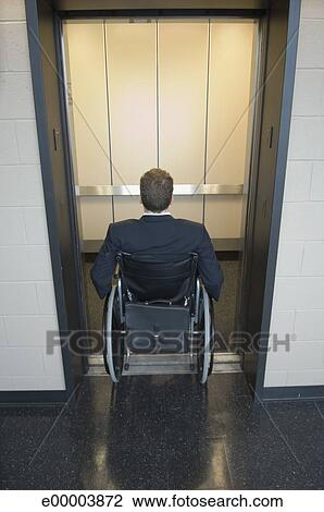 Stock Photo Of Man In Wheelchair Entering Elevator