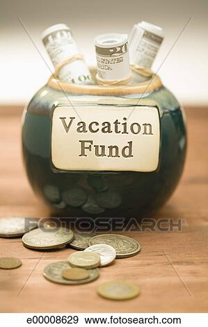 Stock Photograph Of Vacation Fund Jar With Cash And Coins E00008629 Search Stock Photography