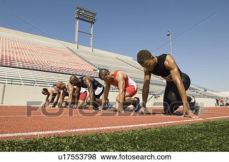Pictures of Runners waiting in starting blocks on track u17553798 ...