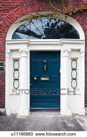Stock Photo - Close up view of traditional Georgian red brick house with ornate arched blue & Stock Photo of Close up view of traditional Georgian red brick ... Pezcame.Com