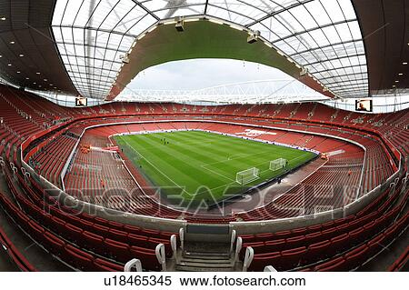 Stock image of england london arsenal inside the for Arsenal mural emirates