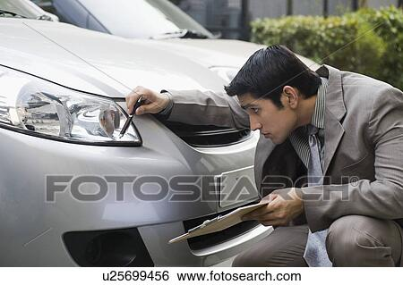 Stock Images of Insurance adjuster inspecting a car u25699456 - Search Stock Photography, Poster