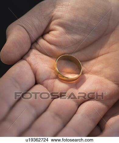 Stock Photo of Hand holding wedding ring u19362724 Search Stock