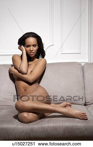 from Eliseo girl sitting on couch naked