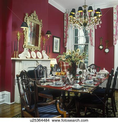 Stock Photo Of DINING ROOM Formal Rectangular Mahogany Table Hepplewhite Style Chairs Crystal And Brass Chandelier With Black Shades Wall Sconces