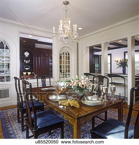 DINING ROOMS Decorator Chinese Style Table And Chairs Dishes Stacked On Arch To Kitchen Two Windows Either Side Of Opening Area