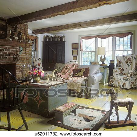 LIVING ROOM: Country Style, Scarf Drapes, Grey Leather Sofa, Draped Quilt,  Painted Trunk, Painted Checkerboard Floor, Horse On Wheels, Hooked Rug,