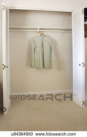 Stock Photography Of Shirt Hanging In Empty Closet San Diego