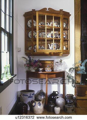Stock Photo   COLLECTION  Wall Display Cabinet With Gaudy Dutch China  Stoneware Jugs On Floor