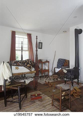 Picture - CHILDREN'S BEDROOMS: Boy's period colonial bedroom. Four poster  bed, cast iron