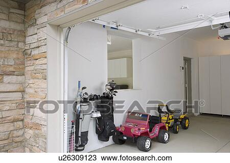 Stock Photo   GARAGE STORAGE: Clean And Organized After Pictures Two Kids  Toy Cars,