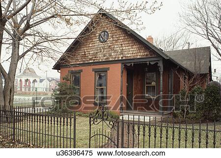 Stock image of exteriors one story and a half story One story victorian homes