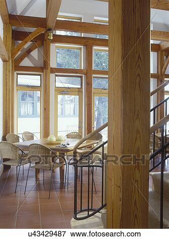Picture of breakfast area 18 foot ceiling natural wood for Natural wood beams