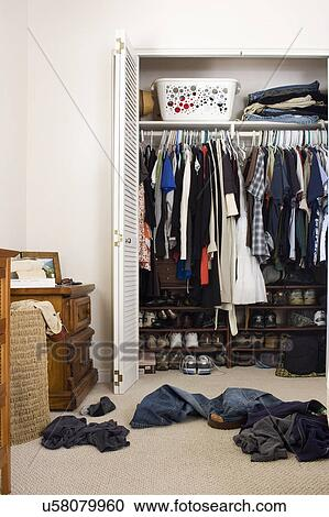 Stock Photography   Scattered Clothes Outside Cluttered Closet, San Diego,  California, United States