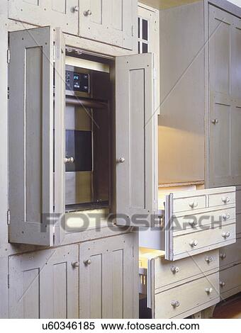 Stock image of kitchens cream color distressed custom - Cream distressed kitchen cabinets ...