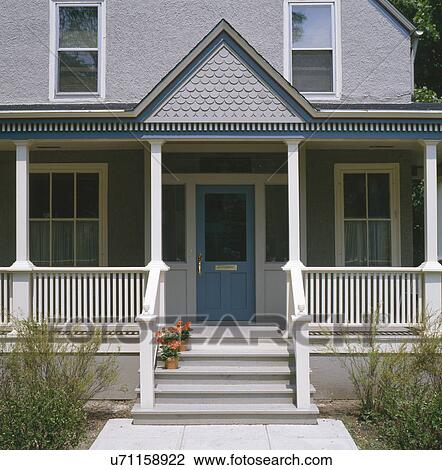 Front Porch Clipart stock photo of front porch of gray stucco house with dark blue