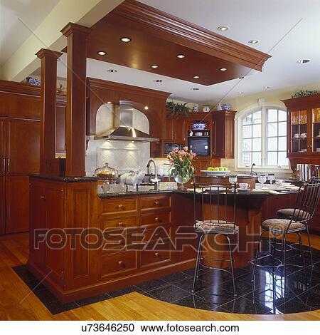 stock fotografie k chen ansicht von kirschen und granit insel mit lose von kurven. Black Bedroom Furniture Sets. Home Design Ideas