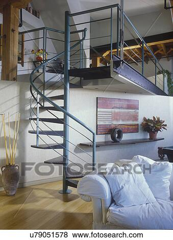 Picture   STAIRWAYS Teal Colored Metal Spiral Staircase In A Loft, Wooden  Floors, Stairs