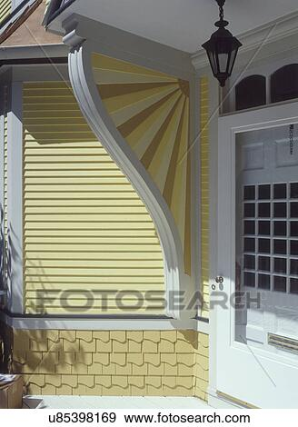 Stock Photograph of ARCHITECTURAL DETAILS Remolded Victorian house front entrance detail of fan shaped support bracket for roof over front door ... & Stock Photograph of ARCHITECTURAL DETAILS: Remolded Victorian ... pezcame.com