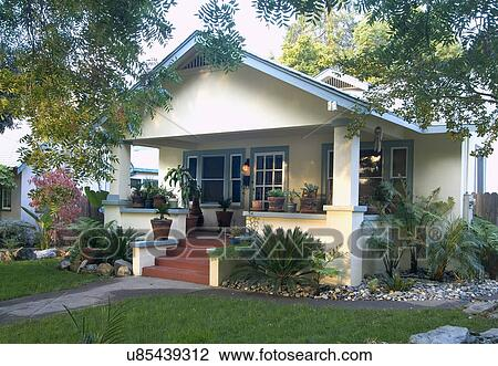 Stock Photo Of Front Exterior Yellow Bungalow With Green Trim