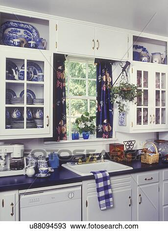 Wonderful Stock Photo Of KITCHENS   White Cabinets, Blue Laminate Counter Top, Sink  Area, Window, With Blue Curtains, Blue Willow Pattern China In Cupboards,  ...