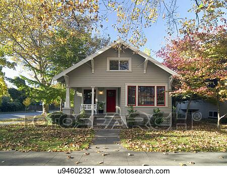 Stock photography of front exterior gray bungalow with red for Californian bungalow front door