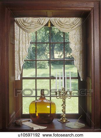 Stock Photo - WINDOW TREATMENTS: Daniel Boone home. Hand-blown colored  glass jug