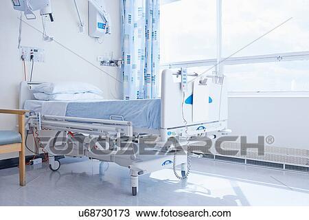 Stock Photo of Empty hospital bed on hospital ward ...