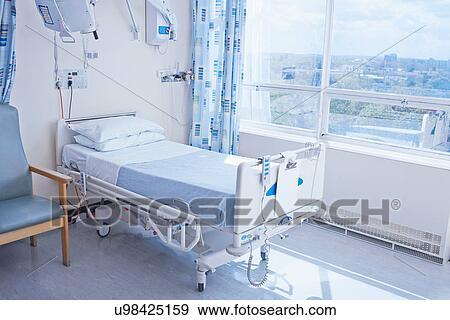 Stock Photograph of Empty hospital bed on hospital ward ...