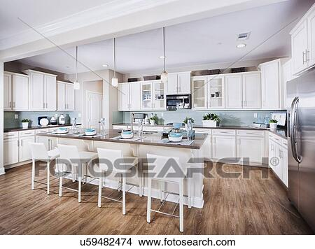 Stock Photo   Barstools At Breakfast Bar In Domestic Kitchen; Indio;  California; USA