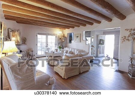 ... Santa Fe; New Mexico; USA. Stock Photography   Seating Furniture With  Exposed Ceiling Beams In Spacious Living Room At Home;