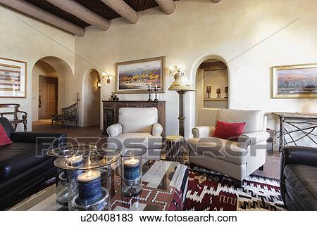 Stock Photo   Living Room With Seating Furniture And Picture Frames At  Home; Santa Fe